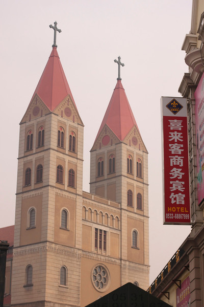 Off to the side of St. Michael's Cathedral, in Qingdao, China I found this man doing Tai Chi.